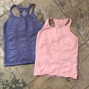 2 free people movement workout tops